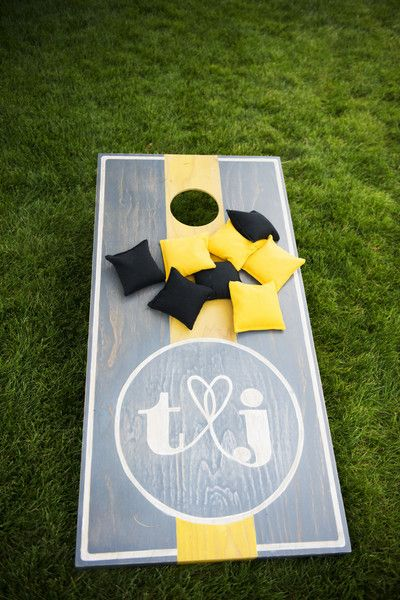 Loving this! What a classy cornhole board! {Two One Photography}