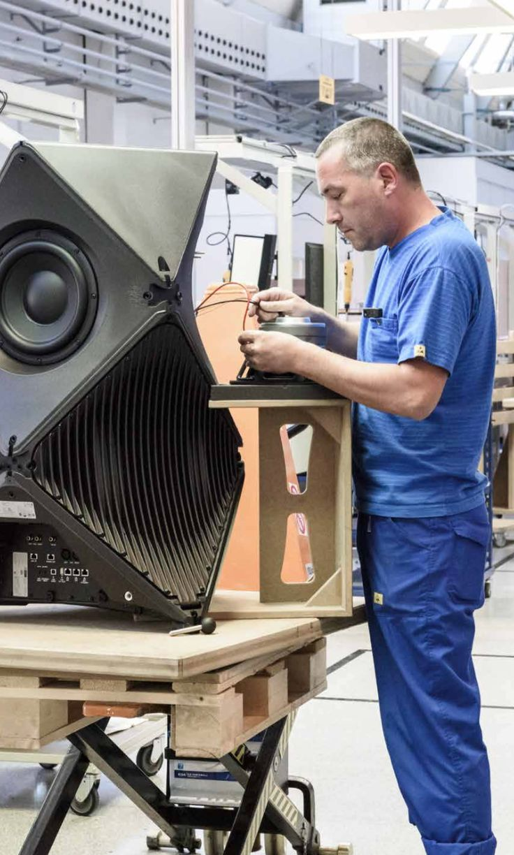 BeoLab 90 in the making! A Bang & Olufsen employee is mounting bass drivers inside the aluminium body.