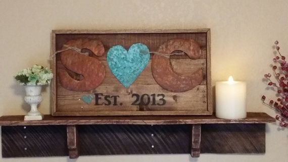 It is wedding season...here is the perfect custom gift!! Two rusted 7 hammered metal letters with a patina heart between the letters. (Each letter and