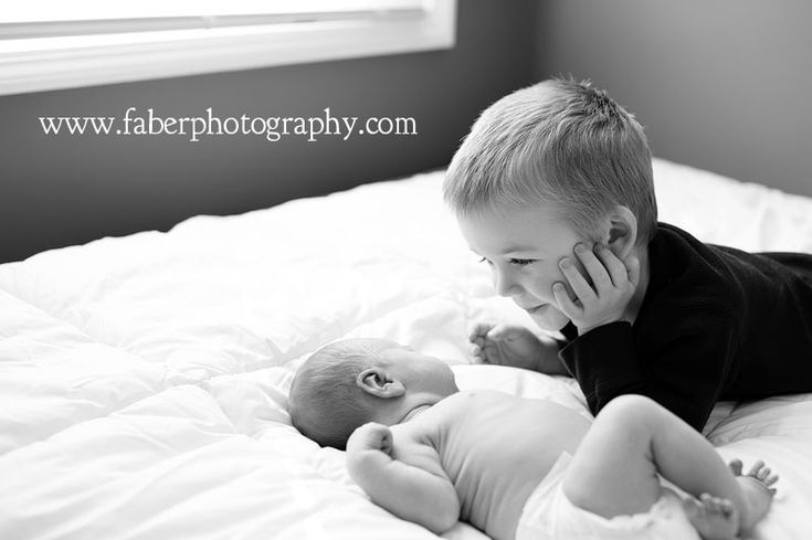 newborn sibling shot. Love how enraptured brother is with new baby!!