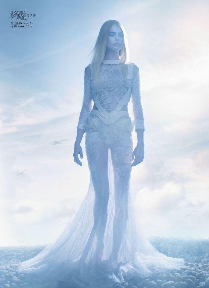 Sølve Sundsbø photographs some of the season's most ethereal looks with these stunning images featured in the December issue of Vogue China. With Cara Delevingne as an angel on earth, fashion editor Nicoletta Santoro selects a wardrobe of ivory gowns from labels such as Versace, Givenchy Dior and Alexander McQueen to complement the otherworldly landscape. / Makeup by Polly Osmond, Hair by Shon