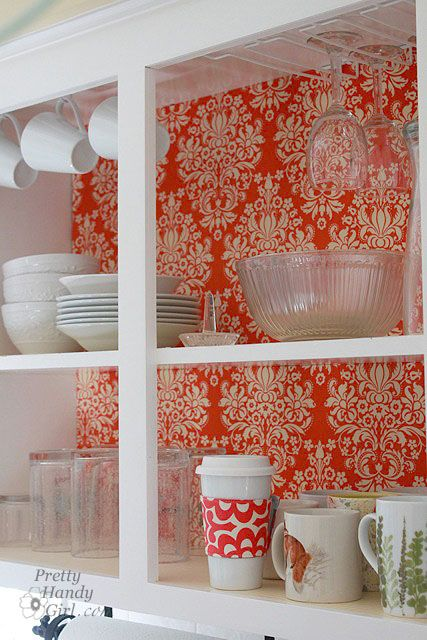 Add a splash of color and pattern to you kitchen by adding contact paper or fabric to the backside of glass or open cabinets