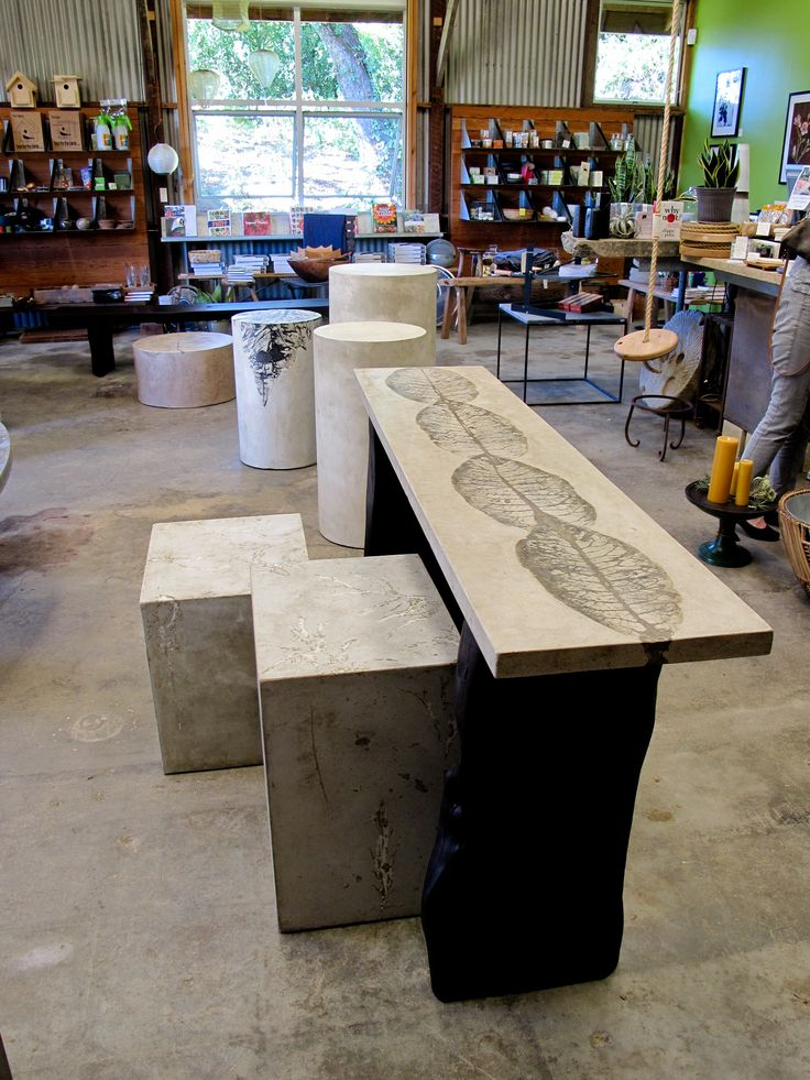 concrete top console on a burnt and waxed cypress base 14x60x32 www.holmeswilson.com