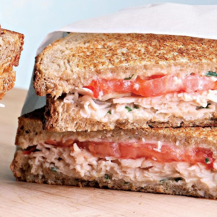 A creamy spread full of Parmesan and fresh basil cozies up to turkey and summer-ripe tomato slices for a savory hot sandwich that will quickly become a go-to mealtime solution.