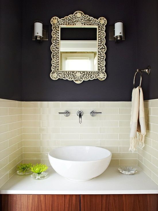 I don't know if I'd pick this for my bathroom but I love the contrast of the dark wall, silver mirror, white tiles and wood