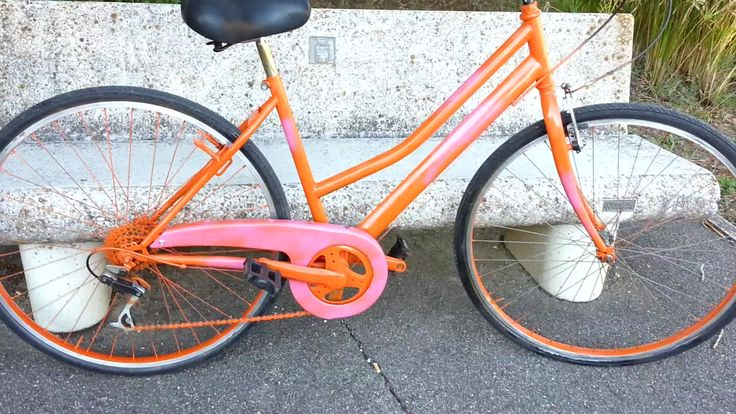 Orange bicycle spray painted with acrylic