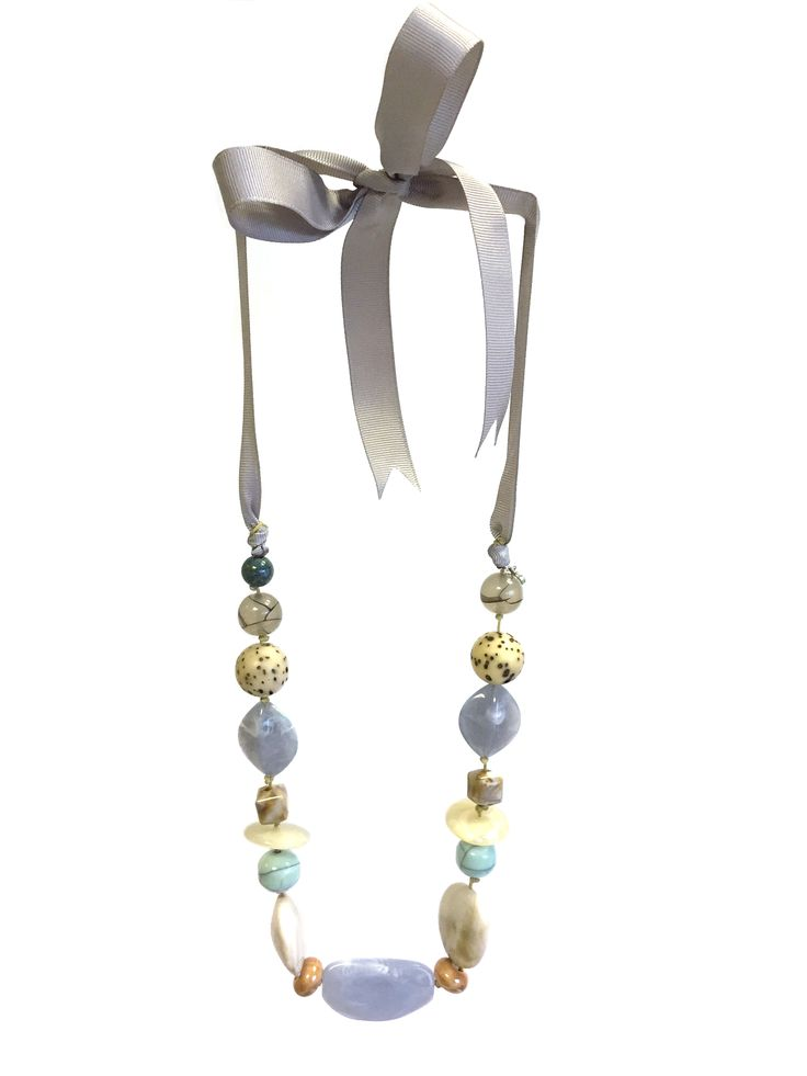 One Button Carol necklace - mixed ceramic/acrylic beads on grosgrain ribbon necklace #seashore #pastels #beautifulblues #necklace #accessories #onebutton  Click to buy from the One Button shop.