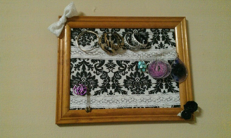 picture frame earing holder (same material as hair band holder, so the two match) : lace for hook earings and chains for hoop or earings that have closed backs. simple and fun