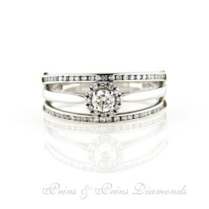 9k white gold ring with one 0.18ct IJ SI round brilliant cut diamond with 0.30ct round brilliant cut diamonds micro set in the band.  1R07029