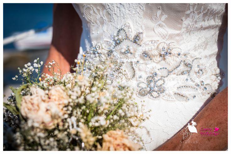 Lovely beaded wedding dress design!