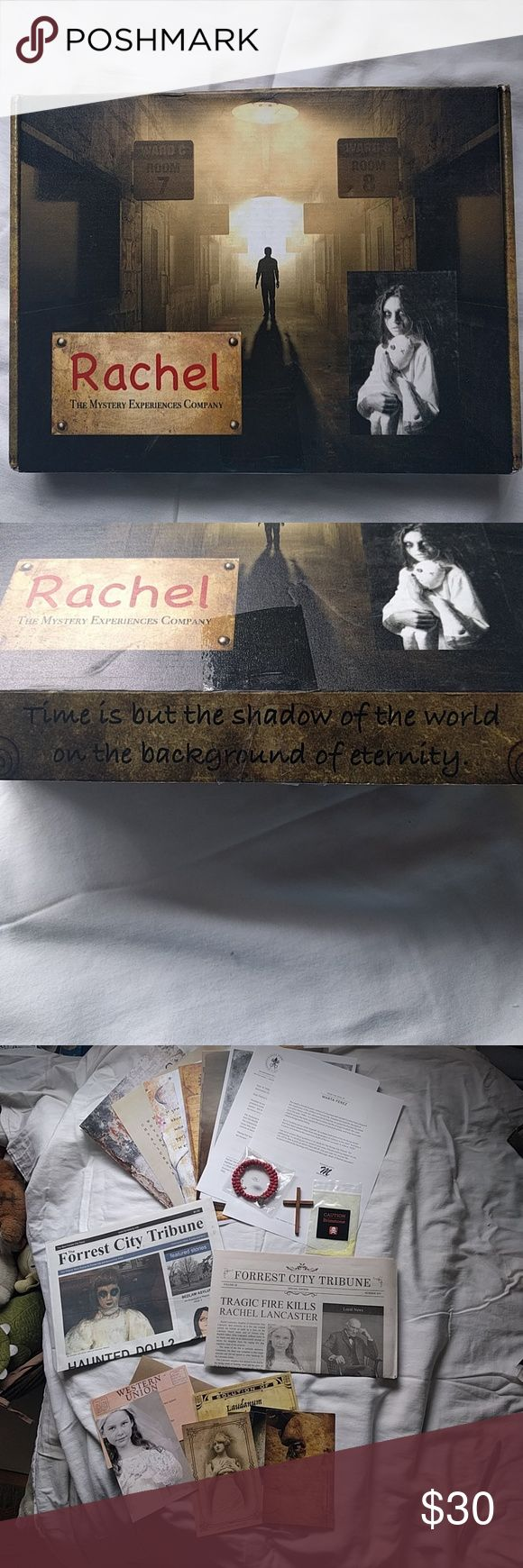 Rachel The Mystery Experience Company Game I opened the box and looked at it. Never used. All pieces are there. Got as a mysterious Birthday gift from a friend.   It is a 'Who Done It' story/game. There are several and this one is about a girl named 'Rachel' and a doll named 'Caroline'. Using all of the clues, you are the detective that must find out what happened to Rachel and is the doll, Caroline, really to blame?  If you like the Escape Rooms games, this is like those. Other