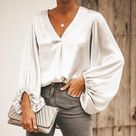 Description Product Name Fashion v collar plain pagoda sleeve loose blouse Brand... 11