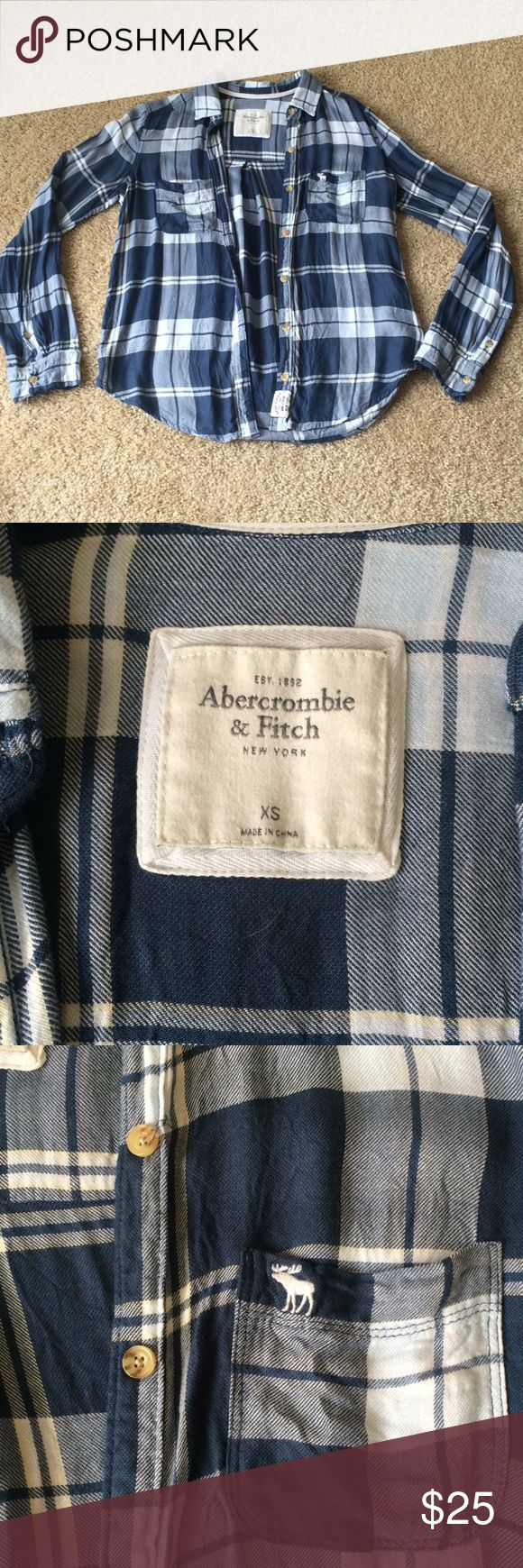 Blue Abercombie and Fitch plaid shirt Lightly worn blue plaid button up shirt from A&F. Doesn't have any flaws, loose fitting. This isn't flannel material, it's a lighter fabric perfect for spring. Abercrombie & Fitch Tops Button Down Shirts