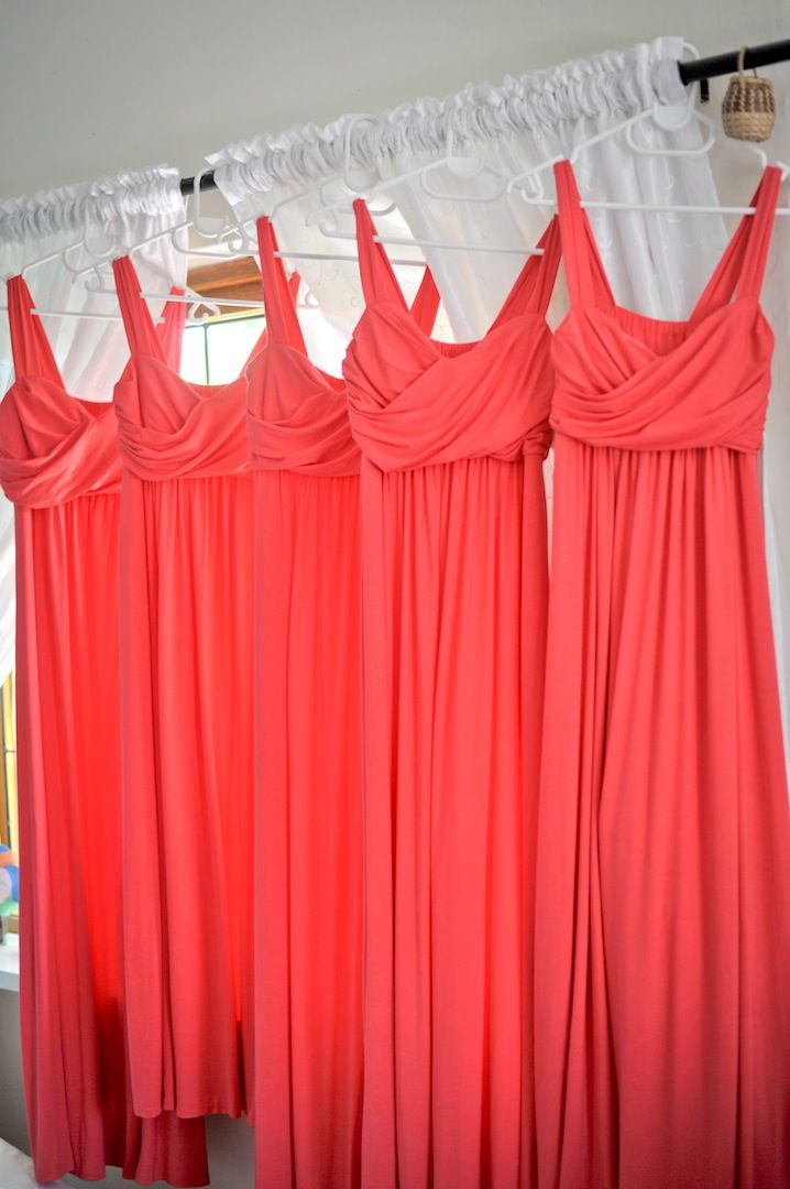 Striking coral, bridesmaids dresses