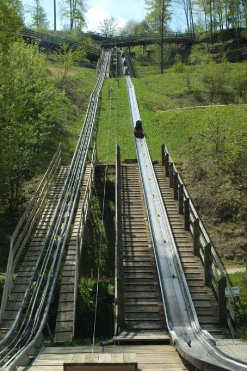 Pottenstein, Germany:    A toboggan makes the slow trek to the top of the Sommerrodelbahn course. It takes between two to five minutes to reach the end of the approximately 3,500-foot (1,000 meter) course, located in Pottenstein, Germany.