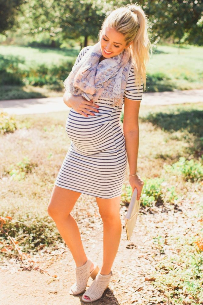 This striped fitted short sleeve maternity dress is the perfect chic look you need this year. A casual style with a striped print for an effortlessly trendy ensemble you won't want to go without. Simply style this dress with flats and a maternity cardigan for a timeless look you can wear to any occasion.