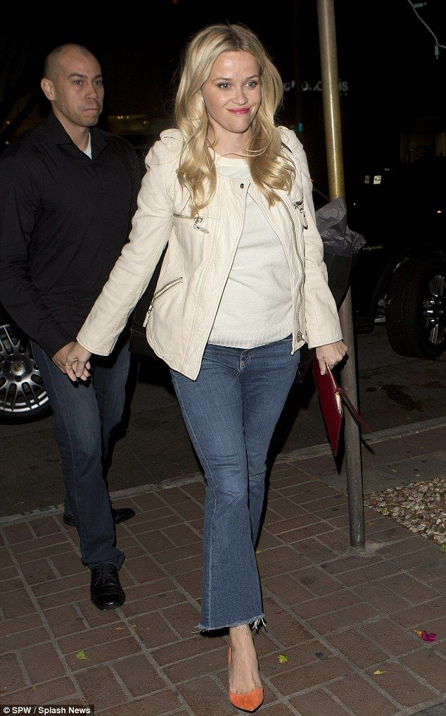 Southern belle: Reese Witherspoon dressed down in flared blue jeans to dine on traditional...