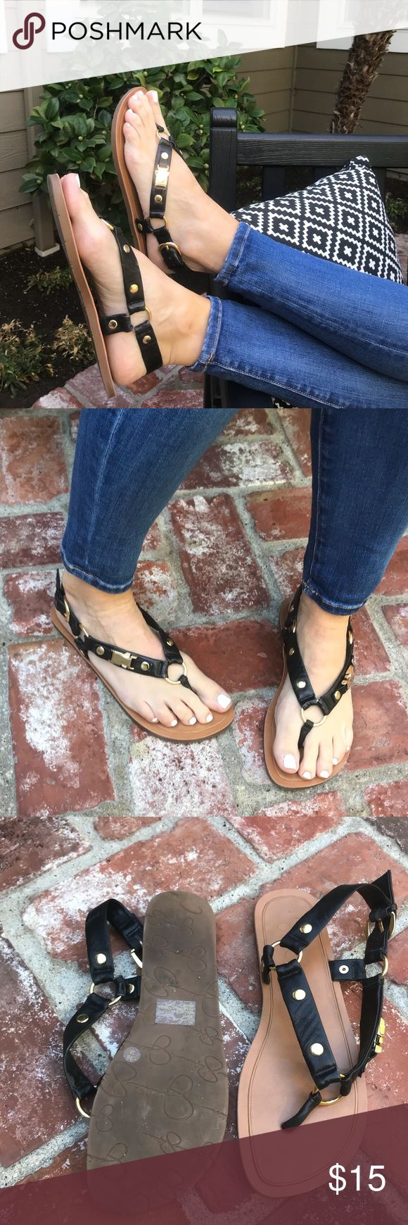 Jessica Simpson Sandals Flat sandal w/ tan sole & black t-strap w/ gold grommets. Shoes are very comfortable to walk in & wear; hardly worn in good condition. Top of sole is very clean. Jessica Simpson Shoes Sandals