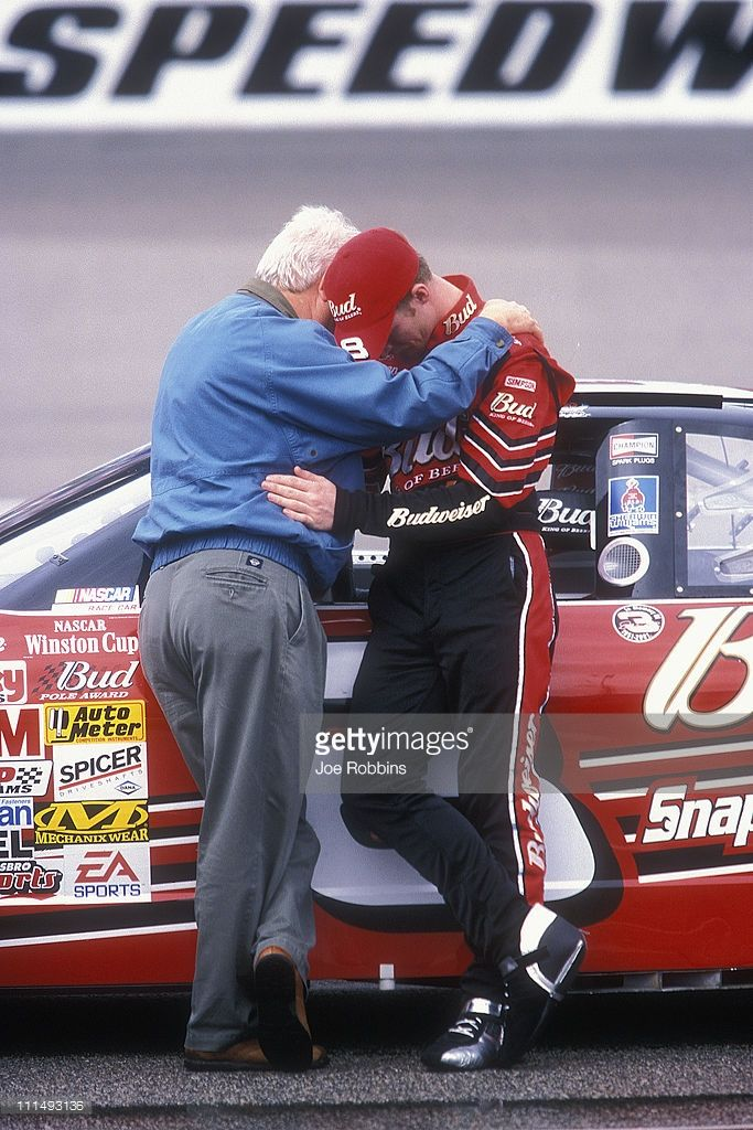 Dale Earnhardt Jr. is consoled by a friend before a NASCAR race at North Carolina Speedway on February 25, 2001 in Rockingham, North Carolina following Dale Earnhardt's death at Daytona the week before.