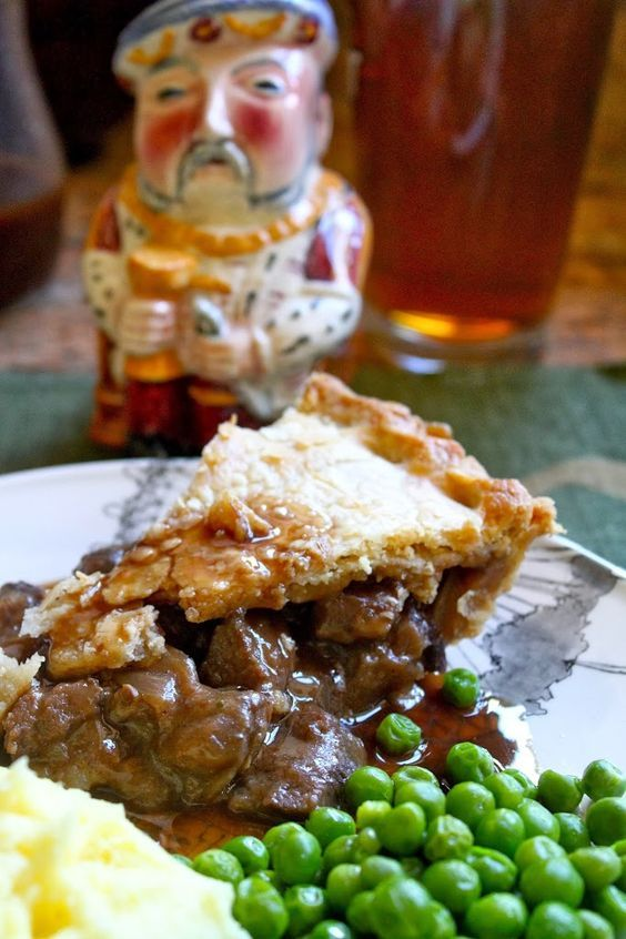Steak pie is a quintessential British dish. Imagine a thick hearty stew enveloped in a flaky, savory crust served with gravy!