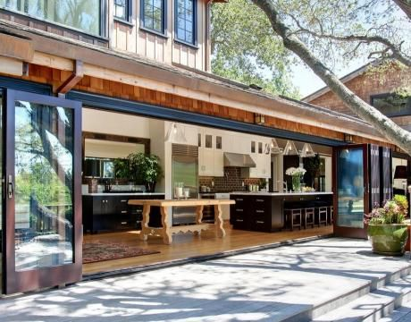 Amazing open kitchen. Look at those doors!