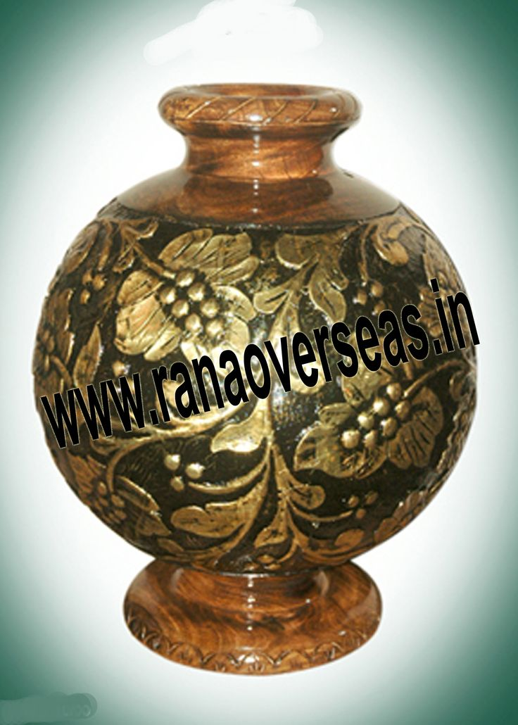 These Wooden Flower Vases. Hand Work Is Also Done On Wooden Flower Pots, Wooden Vases.Our Wooden flower vases designed by artist beautifully showcase the traditional as well as modern designs. Wooden Flower vases are designed in styles ranging from exquisite to outrageous ones. These Flower vases chiseled out of variety of materials in varied shapes are extremely eye-catching with their compelling beauty.