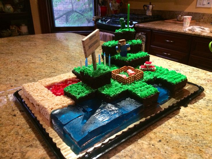 Minecraft cake with jello water & lava, Rice Krispie treats sand and fondant figurines. The pigs are my favorite!