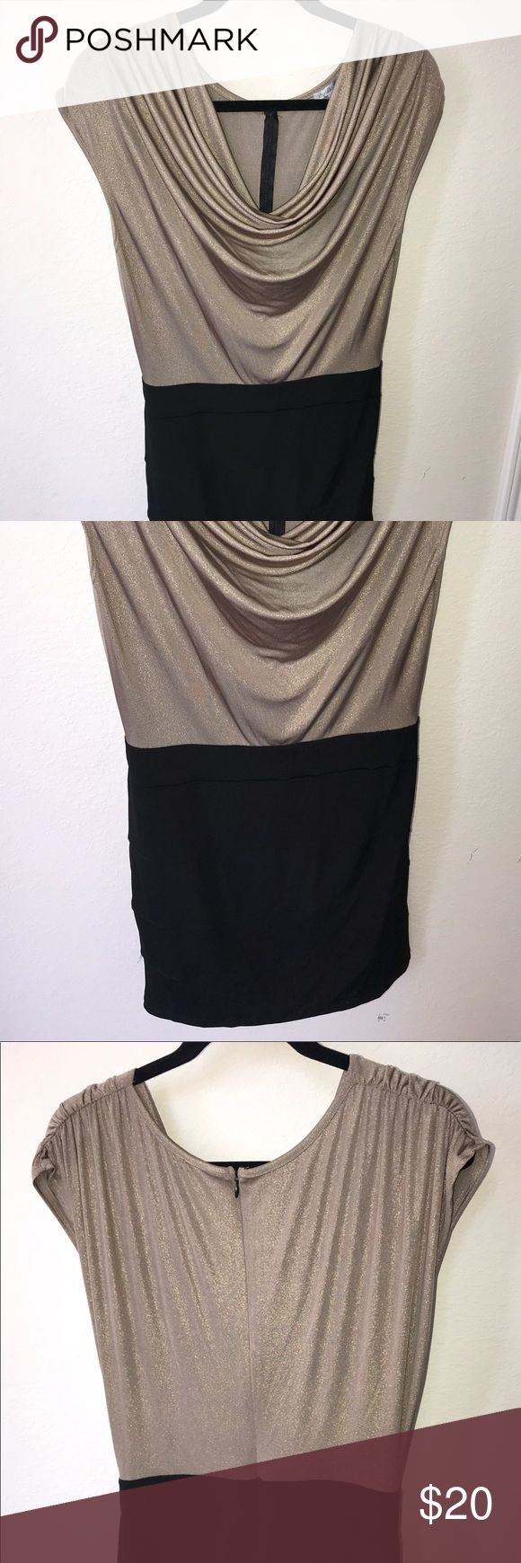 Never Worn* Charlotte Russe metallic mini dress Metallic gold top and black bandage bottom. I bought this for New Year's Eve, buuuut I got sick, didn't go out, so it's never been worn. Charlotte Russe Dresses