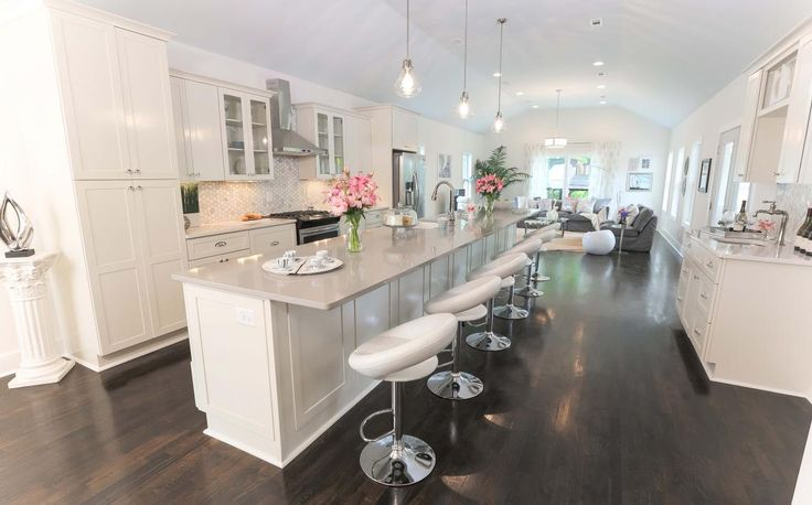 This is a very large room, very large space. The kitchen island makes the room feel smaller. Great use of space.