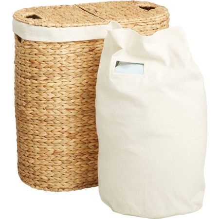 Bring style and ease to your master suite walk-in or laundry room with this woven hyacinth hamper, featuring 2 compartments with removable liners.