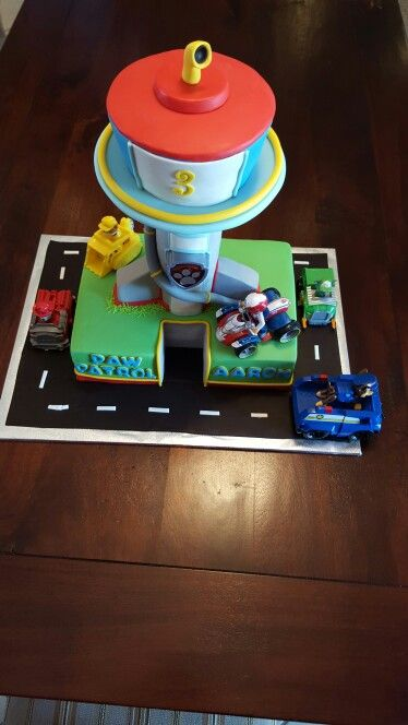 Paw Patrol Lookout Tower Cake complete with a button full of Paw Patrol sayings. #talkingcake #creativebaker