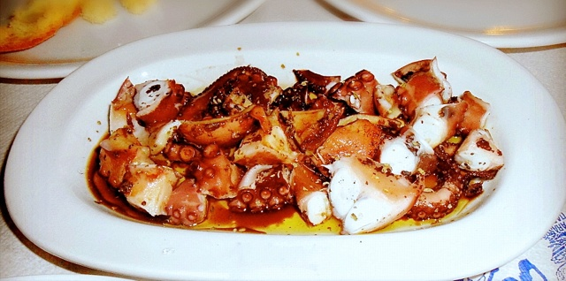 Greek octopus marinated with vinegar-served with olive oil oilvetomato.com