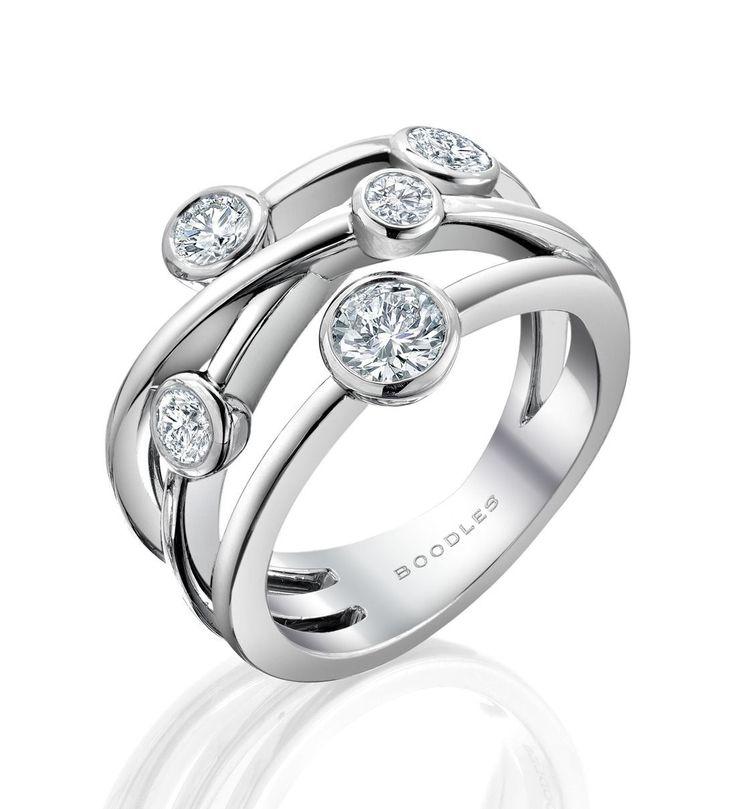 <p>A contemporary, versatile diamond ring from Boodles' Raindance collection</p> <ul> <li>Set with 0.81ct of round-brilliant cut diamonds</li> <li>In platinum</li> </ul> <p>Width: 14mm (approx.).</p>