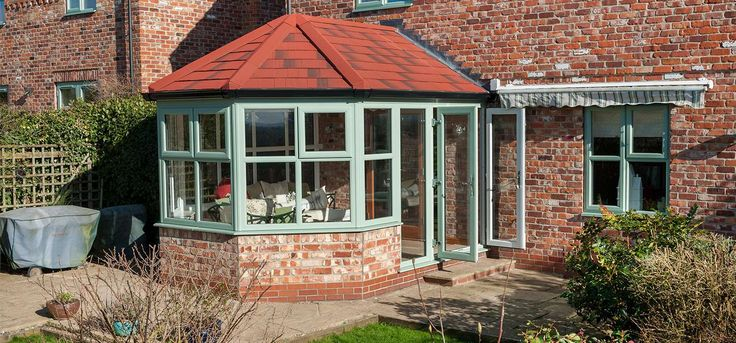 Green Victorian Conservatory With Solid Tiled Roof from Conservatory Outlet