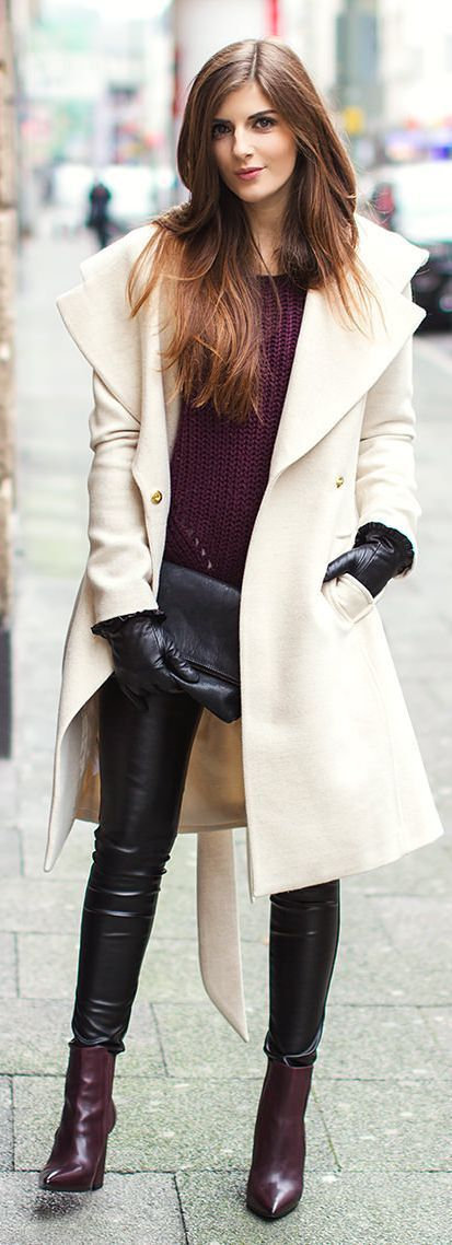 Shop this look on Lookastic:  http://lookastic.com/women/looks/cable-sweater-coat-clutch-gloves-skinny-pants-ankle-boots/8980  — Dark Purple Cable Sweater  — Beige Coat  — Black Leather Clutch  — Black Leather Gloves  — Black Leather Skinny Pants  — Dark Purple Leather Ankle Boots