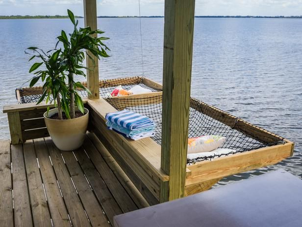 Built-in hammocks float over the lake.  This would even be neat in your back yard. Less chance of flipping out of the hammock!