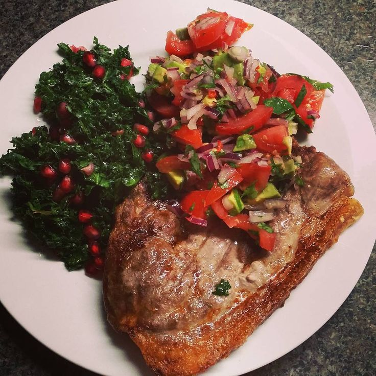 Grilled pork chop, kale and pomegranate salad and a VERY spicy avo salsa  #cleaneating #refinedsugarfree #glutenfree #wholefoods #homemadegoodness #grainfree #primal #greengoodness #vegegoodness #dairyfree #mmmspicy #chilihot #chilliaddict #paleoeats #primaleats #primalfood #cleaneats #freshisbest #homegrownveg #paleofood  #paleo #paleofoodie #paleolifestyle #primalfoodie #jerf #eatarainbow