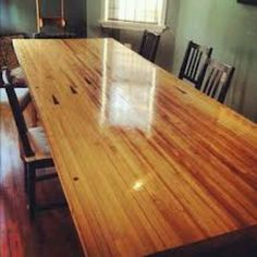 Table made from reclaimed bowling alley lane maple.