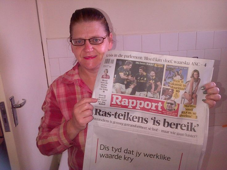 Me reading the local newspaper!