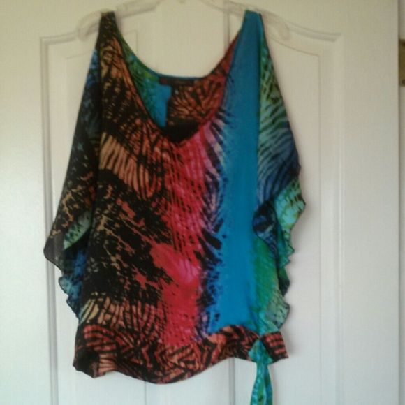 cute multi coloured top it reminds me of katy perrys song roar super