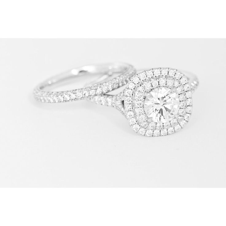 Handmade double halo engagement ring in platinum with matching wedding band