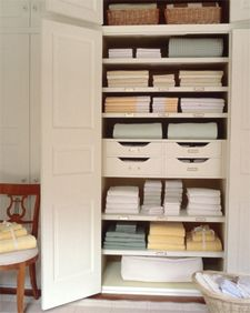 We actually have a double linen closet including a built in set of drawers in the hallway. Definitely time to invest in some organizational linen strategies. I shall never have piles falling out of an open closet door again! :D