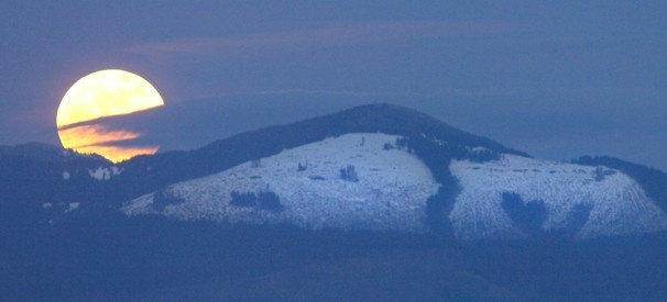 The moon rises over Cultus Mountain in Skagit County, Wash.