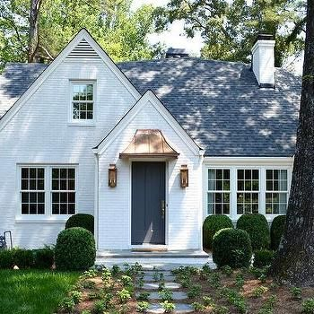 White Brick Cottage Home with Dark Gray Door