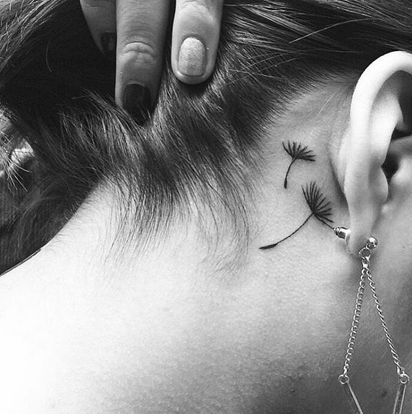 small dandelion tattoo behind the ear
