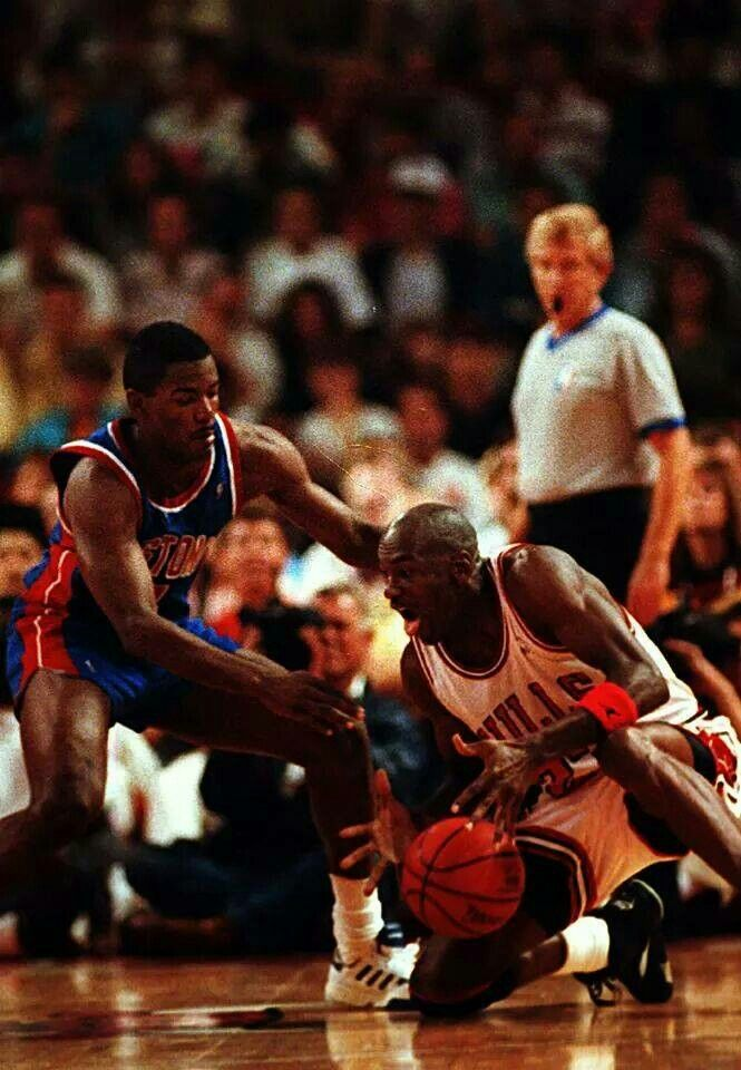 Joe Dumars and the GOAT scramble for a loose ball in Chicago.