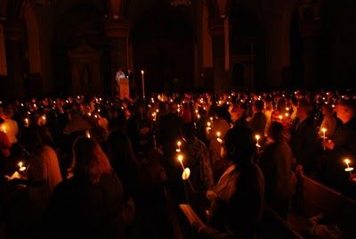 Between The 'Burgh and The City: The Totality  This pictures shows an Easter Vigil Mass at the Church of St. Paul the Apostle on Manhattan's West Side.  The deacon is at the high pulpit in the middle of the church.