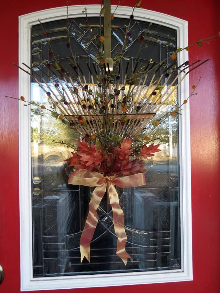 I made this from an old rake head and some fall flowers.  I saw this on< I forget which website> and I do not remember who to give credit to, but I love it!!  THANK YOU for your original post & idea!!