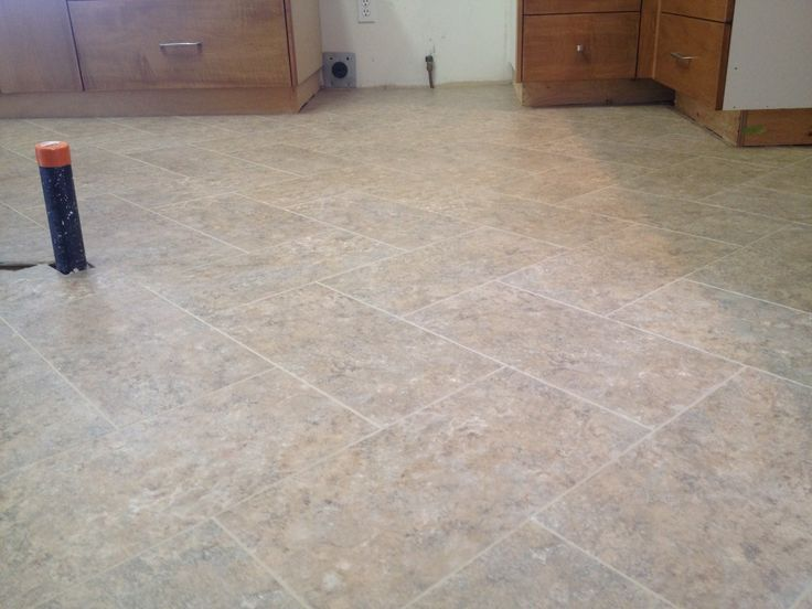 Armstrong alterna tile done in a herringbone pattern a for Kitchen flooring installation