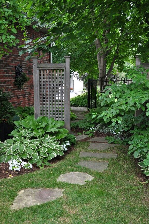 Lattice, red brick house and curved garden path